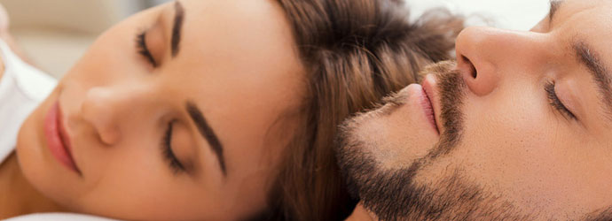 couple-sleeping-header